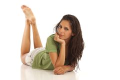 Cute young woman laying down Royalty Free Stock Images