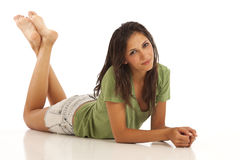 Cute young woman laying down. Portrait of cute young woman laying down Stock Image