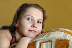 Cute young woman laying on pillow Stock Images
