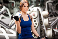 Cute young woman lifting weights Royalty Free Stock Photos