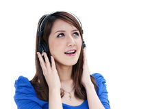 Cute young woman listening to music Stock Image