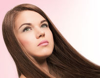 Cute young woman with long hairs Stock Photos