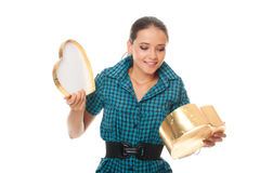 Cute young woman looking into gold  box gift Stock Images