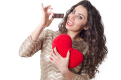 Cute young woman loves to eat chocolate concept Stock Photo