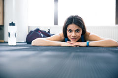 Cute young woman lying on the floor Stock Images