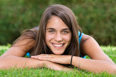 Cute young woman lying on grass Royalty Free Stock Image