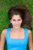 Cute young woman lying on grass Stock Images