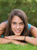 Cute young woman lying on grass Royalty Free Stock Photography