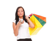 Cute young woman mobile phone holding shopping bag Stock Images