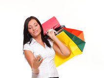 Cute young woman mobile phone holding shopping bag Royalty Free Stock Images