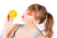Cute young woman with an orange fruit Stock Image