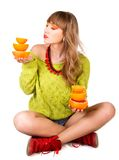 Cute young woman with an orange fruits Stock Photography
