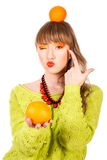 Cute young woman with an orange fruits Stock Photos