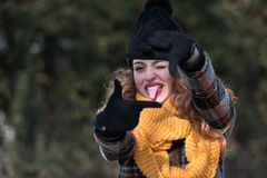 Cute young woman at the park stick tongue out. Making cinema frame with her fingers stock photos