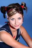 Cute young woman with pigtails. A studio portrait of a pretty, cute young woman in a dark blue summer top, wearing her hair up in two pigtails stock photos