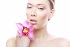 Cute young woman with pink flower Stock Photography