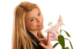 Cute young woman with a pink lily studio isolated over white Stock Photography