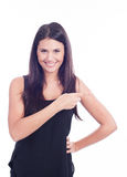 Cute young woman pointing  to the side. A Cute young woman pointing to the side Royalty Free Stock Image