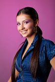 Cute young woman portrait in jeans on pink Royalty Free Stock Photography