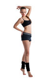Cute young woman posing in fitness cloth Royalty Free Stock Photography