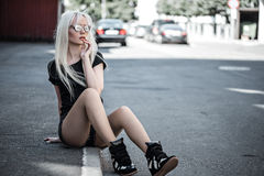 Cute young woman posing outside Royalty Free Stock Image