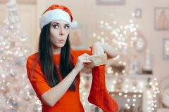 Funny Girl Looking for Her Gift in a Christmas Stocking Royalty Free Stock Images
