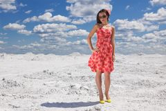 Cute young woman in red dress on the snow Royalty Free Stock Photos
