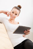 Cute young woman relaxing on the couch Royalty Free Stock Photo
