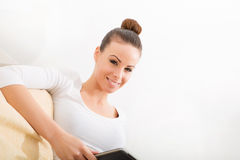 Cute young woman relaxing on the couch Royalty Free Stock Photos