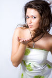 Cute young woman sending a kiss Royalty Free Stock Photos