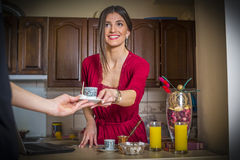 Cute young woman serving coffee Stock Photo