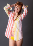 Cute Young Woman in Shirt and Panties Stock Image