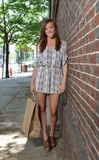 Cute young woman shopping in city Stock Photo
