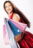 Cute young woman shopping with color bags Stock Photography