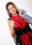 Cute young woman shopping with color bags Royalty Free Stock Image