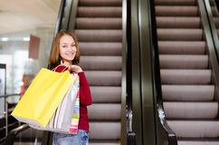 Cute young woman shopping Royalty Free Stock Photos