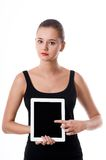 Cute young woman showing blank tablet screen Stock Photos