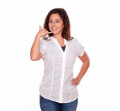 Cute young woman showing a calling gesture Royalty Free Stock Photos