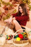 Cute young woman sitting in a hay Stock Photography