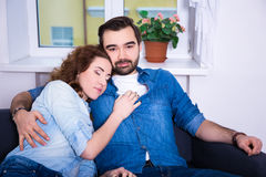 Cute young woman sleeping on shoulder of her boyfriend Royalty Free Stock Photography