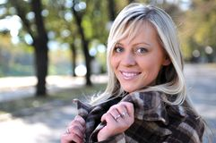 Cute young woman smiling Royalty Free Stock Image
