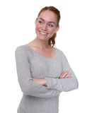 Cute young woman smiling with arms crossed Royalty Free Stock Photos