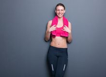 Cute young woman smiling after exercise Royalty Free Stock Photo