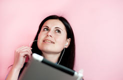 Smiling woman using tablet PC Royalty Free Stock Images