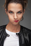 Cute young woman smirking Royalty Free Stock Photos