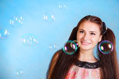 Cute young woman with soap bubbles Royalty Free Stock Photography