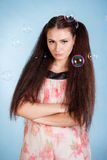 Cute young woman with soap bubbles Royalty Free Stock Image