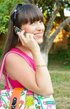 Cute young woman speaking on the mobile stock photo