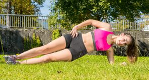 Cute young woman sporty girl workout outdoor Royalty Free Stock Image