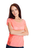 Cute young woman standing with arms crossed Stock Photos